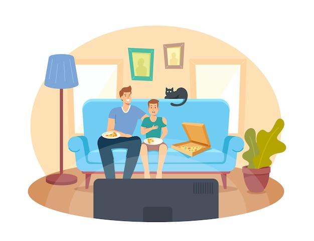 映画を見たり笑ったりしてソファに座っているピザと猫と父と10代の息子。ハッピーファミリーホームシネマ