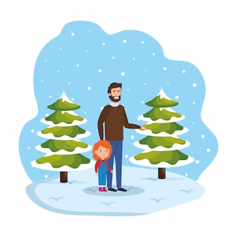 Father and daughter in snowscape