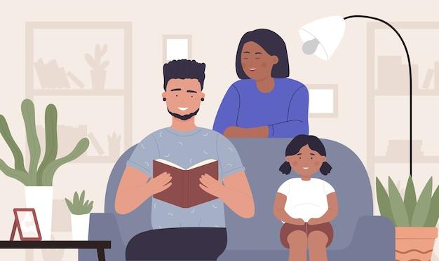 家族のために本を読んでいる父