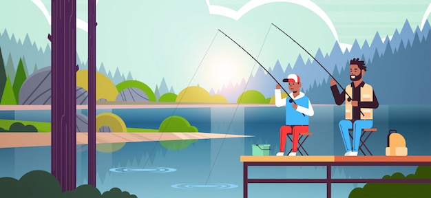 Father and son fishing together from pier man with little boy using rods happy family weekend fisher hobby concept water horizon forest landscape background flat full length horizontal