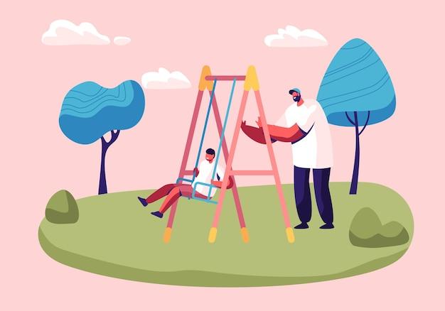 Отец качается ребенка на качелях в парке или спортивной площадке.