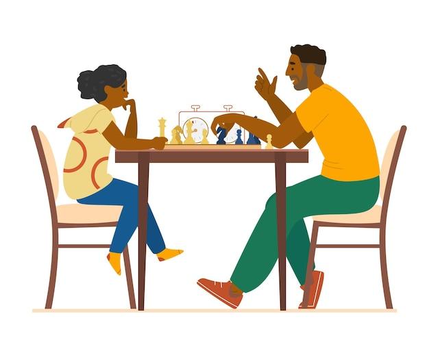 Отец учит дочь играть в шахматы