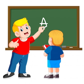 Father teaches little son with chalkboard on background