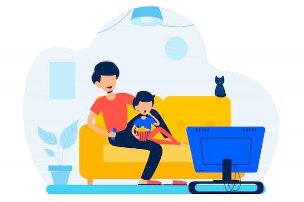 Отец с сыном сидят на диване и смотрят телевизор в гостиной.