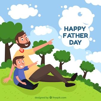 Priorità bassa di giorno di padri con papà e figlio in natura