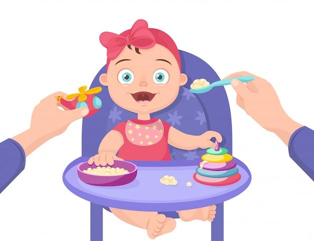 赤ちゃんに離乳食を与える。