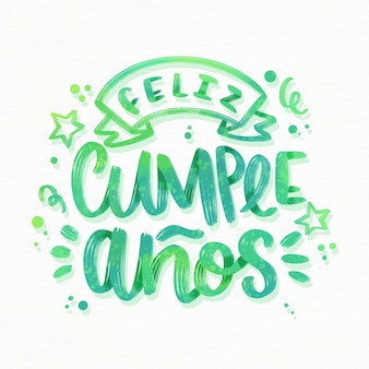 Feliz cumpleaños lettering with ribbon and stars