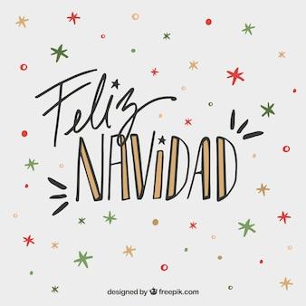 Feliz navidad lettering sfondo su stelle colorate