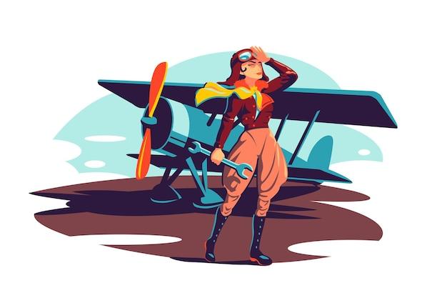 レンチ器具を保持している女性の飛行士