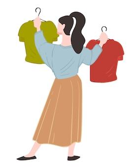 Женский персонаж делает покупки в магазине или магазине, выбирая одежду, висящую на вешалках