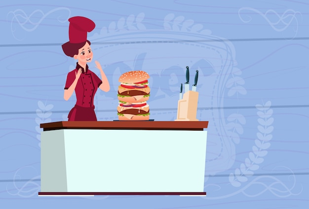 Female chef cook big burger cartoon chief in restaurant uniform over wooden textured background