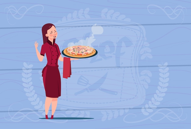 Female chef cook holding pizza cartoon chief in restaurant uniform over wooden textured background