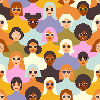 Female diverse faces of different ethnicity seamless pattern