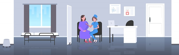 Female doctor examining woman patient by stethoscope checking heart beat or breath medicine healthcare concept modern hospital room interior full length horizontal
