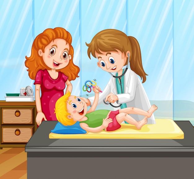 Женский доктор дает лечение маленького мальчика