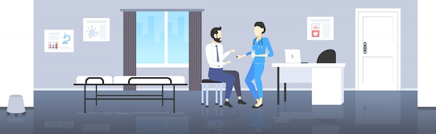 Female doctor giving pill and glass of water to male patient pharmacist offering pills medication healthcare concept modern hospital room interior full length  horizontal