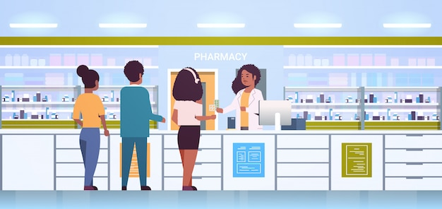 Female doctor pharmacist giving pills to customers african american patients at pharmacy counter modern drugstore interior medicine healthcare concept horizontal full length