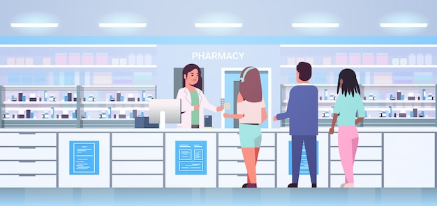 Female doctor pharmacist giving pills to mix race customers patients at pharmacy counter modern drugstore interior medicine healthcare concept horizontal full length