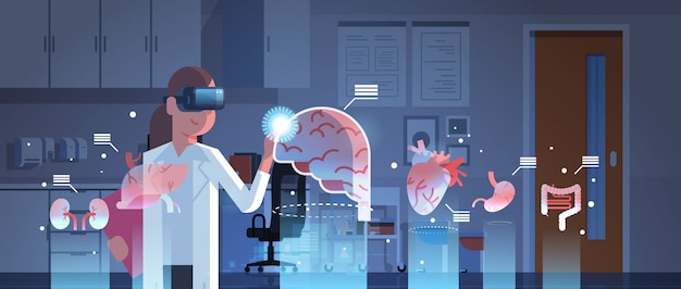 Female doctor wearing digital glasses looking at virtual reality organs