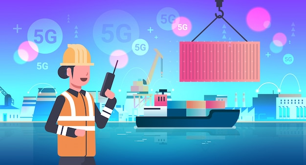 Female engineer using walkie-talkie controlling crane hook lifting cargo container box on ship 5g online wireless system connection industrial zone sea shipment concept horizontal portrait