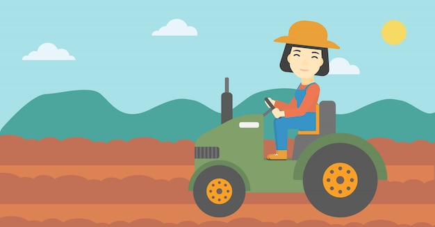 Female farmer driving tractor