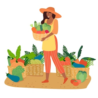 Female farmer holding a wicker basket with various vegetables.