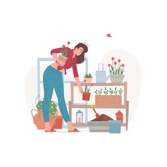 棚の図に鉢植えの花を配置する女性の花屋