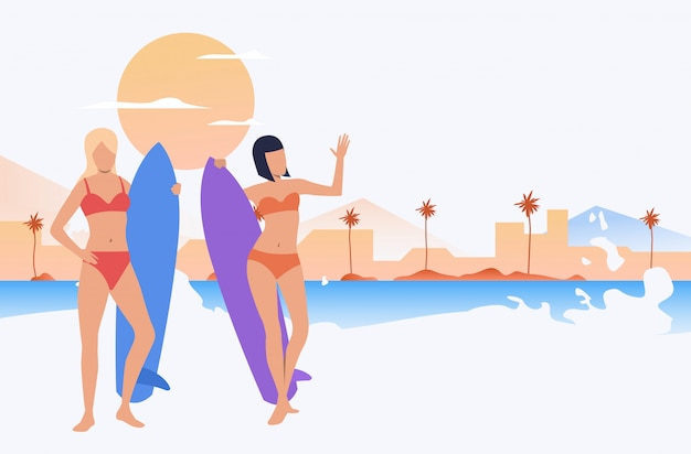 해변에 서있는 수영복에 여자 친구