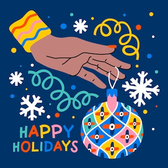 クリスマスツリーの装飾を持っている女性の手