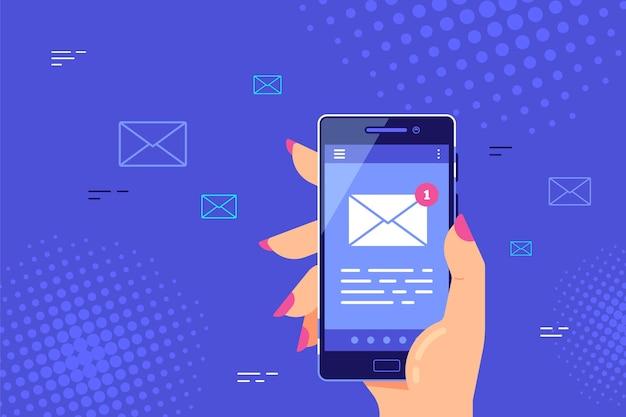 画面上の文字アイコンでスマートフォンを持っている女性の手。携帯電話のメールアプリ、新着メッセージ。 。