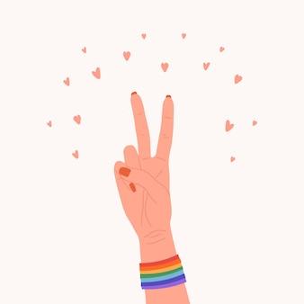 レインボーバンドと平和ジェスチャーで女性の手。ゲイパレード要素。 lgbtの権利。