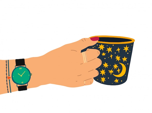 A female hand with a beautiful manicure, jewelry, and a clock holds a cup of tea.