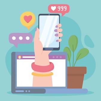 ソーシャルネットワークのコミュニケーションとテクノロジーをフォローするようなラップトップでのスマートフォンを持つ女性の手