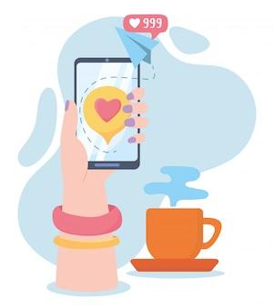 ウェブサイトのコーヒーカップのソーシャルネットワーク通信と技術のようなスマートフォンを持つ女性の手