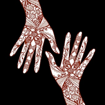 Female hands covered with traditional indian mehendi henna tattoo ornaments