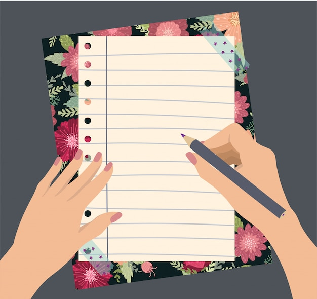 Female hands hold a pencil with beautiful flowers notepad