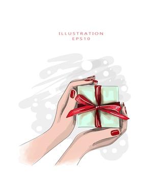 빨간 매니큐어와 여성의 손을 잡고 붉은 활과 선물 상자