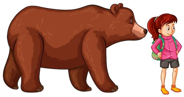 Женский турист и большой медведь