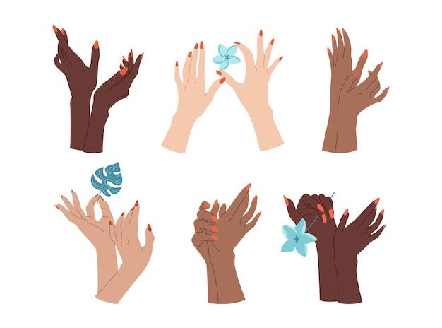 女性の手入れの行き届いたネイルハンドセット、デモンストレーションマニキュア、花のある多民族の腕。マニキュアデモンストレーションジェスチャー。フラットスキンケア、さまざまな国スパビューティートレンディ