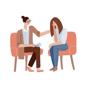 여성 심리학자는 여의사가 정신분석 세션을 진행하고 있는 환자를 격려합니다.