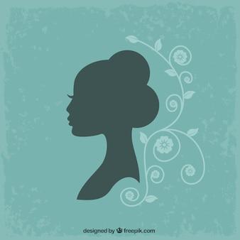 Женский силуэт на бирюзовом фоне