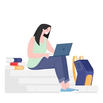 책 노트북과 배낭에 앉아 여자 학생