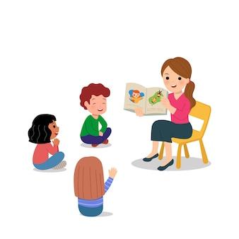 幼稚園児へのお話をする女教師。学校やデイケアでのグループ活動。世界の先生の日。白。
