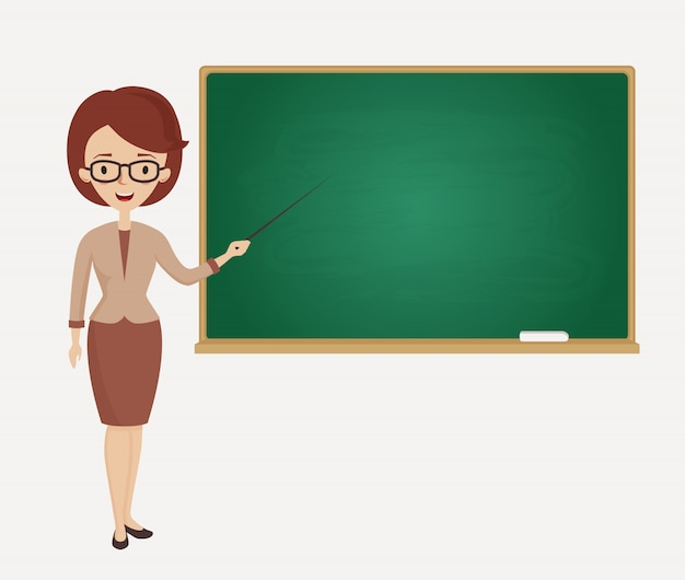 Female teacher stands at the blackboard.