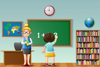 Female teacher with school girl in a classroom