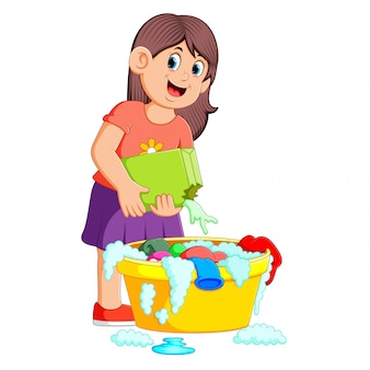 Female washing clothes in basin with detergent