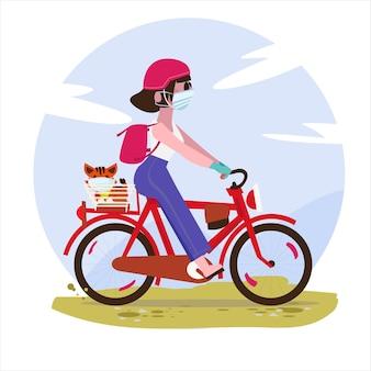 Женщина в маске с кошкой на велосипеде