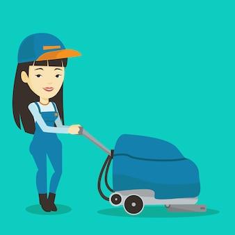 기계와 매장 바닥을 청소하는 여성 노동자.