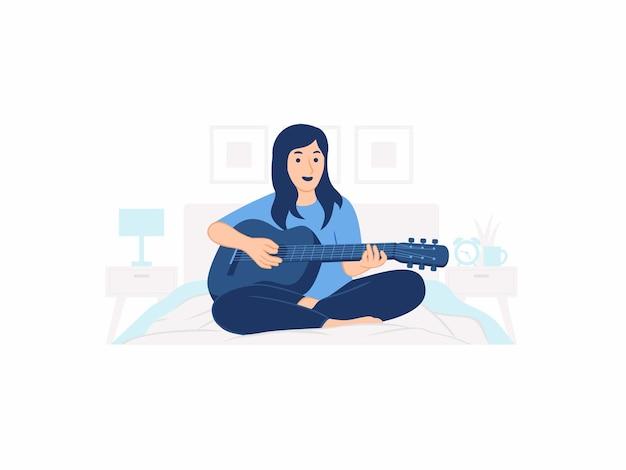 Девушка молодая женщина сидит на кровати дома, играя на гитаре музыкальная концепция иллюстрации