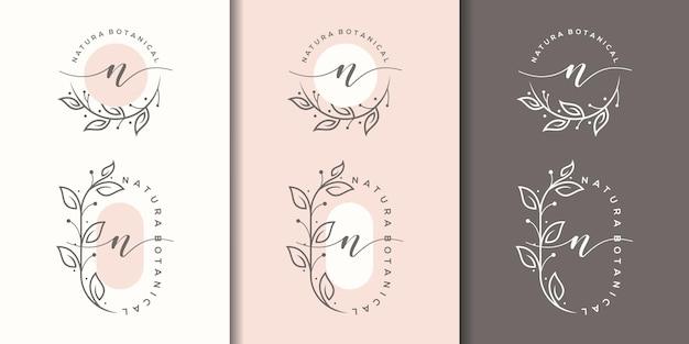 Feminime letter n with floral frame logo template